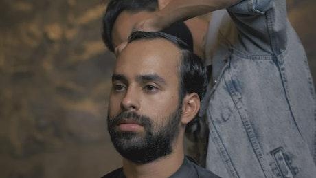 Cutting a man's hair in a barbershop
