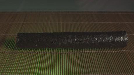 Cutting a roll of Sushi