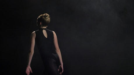 Dancing alone in a dark room