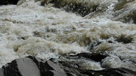 Dangerous river flowing over rocks