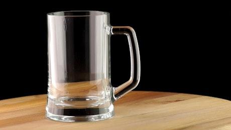 Dark beer poured into a transparent mug