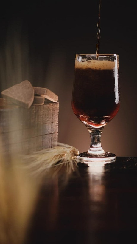 Dark beer with a lot of foam in a beautiful image composition