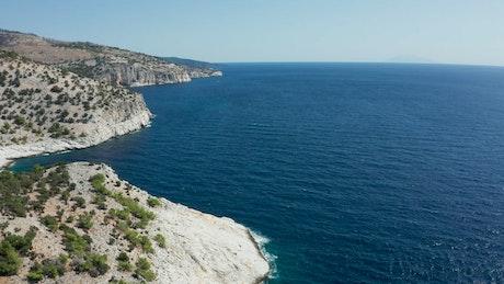 Dark blue ocean and white coastline