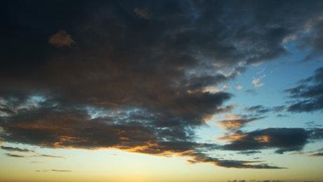 Dark clouds at sunset, landscape