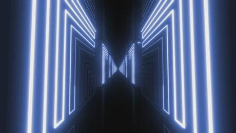Dark corridor between blocks with blue neon lights