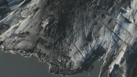 Dark glacier ice, top view