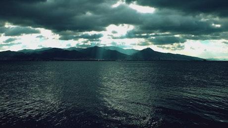Dark landscape of a calm sea and a cloudy sky