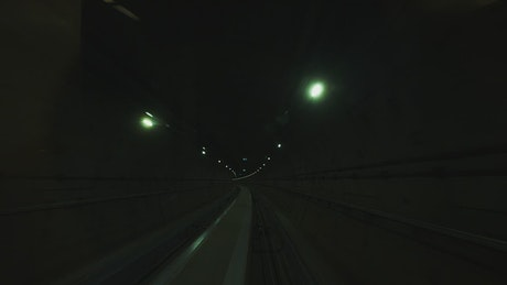 Dark subway tunnels with small lights