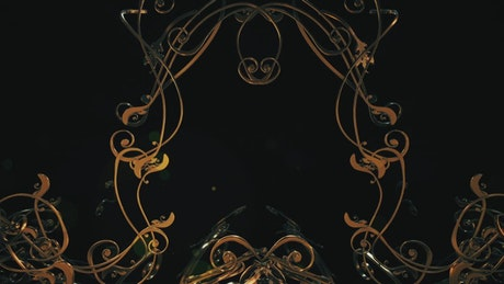 Dark tunnel with golden shapes in rococo style