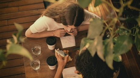 Date between two girl friends in a coffee shop