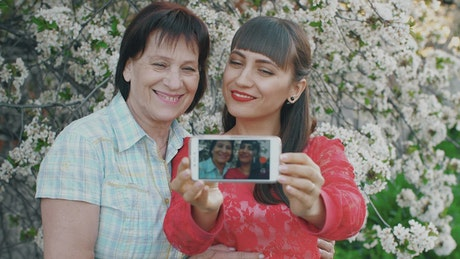 Daughter takes a selfie with her mother
