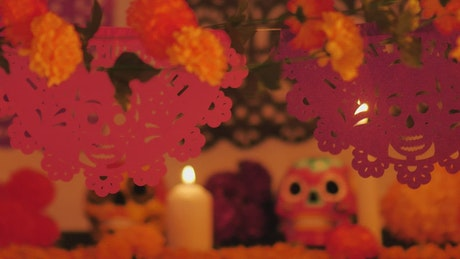 Day of the Dead altar under color changing lights