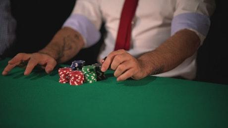 Dealer dealing cards during a poker game