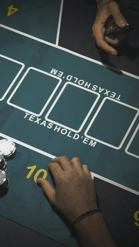 Dealer dealing cards on a game table for poker