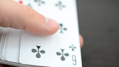 Dealer placing cards on a game board