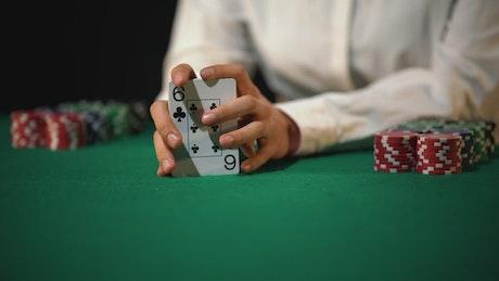 Dealer shuffling poker cards