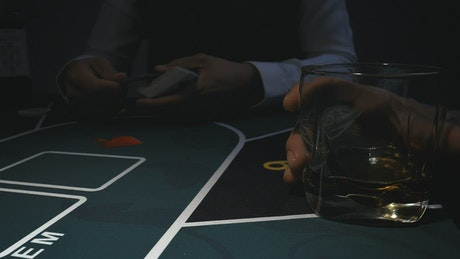 Dealing cards on a poker game table