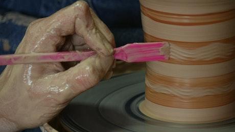 Decorating a clay pot