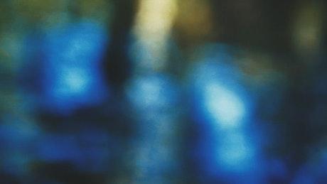 Defocused blue lights reflected in water