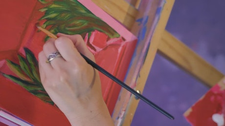 Delicate painting of an artist on a canvas on an easel