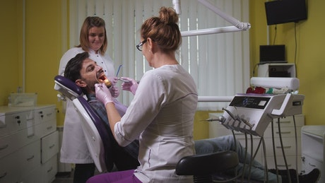Dental assistant working with a patient