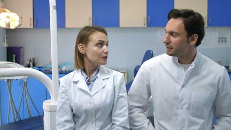 Dental staff talking in a clinic