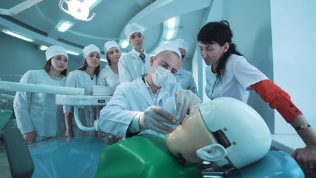 Dental students watching a dental procedure