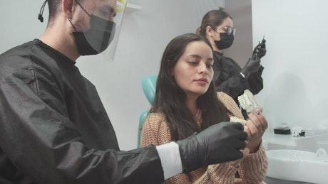Dentist explaining a denture to his patient