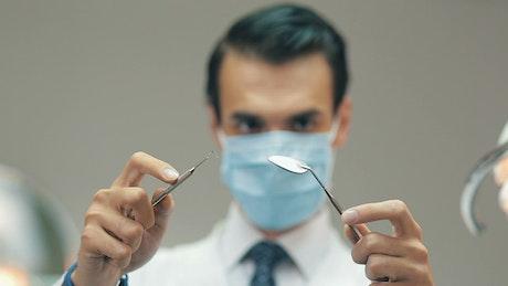 Dentist holding tools
