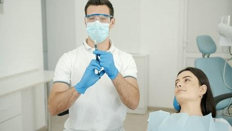Dentist preparing anesthesia