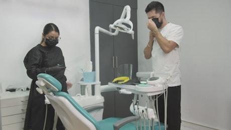 Dentist preparing to work