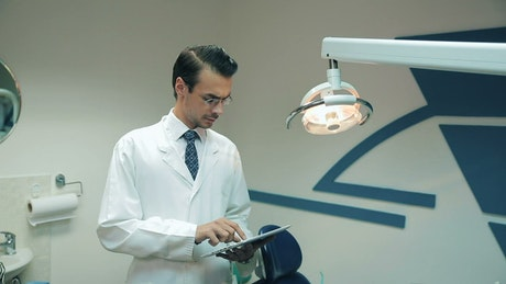 Dentist reviewing data on his tablet