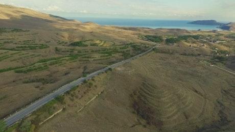 Desert road leading to the open ocean