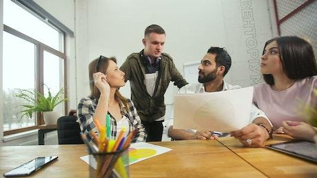 Design team review prototype in modern minimalist office