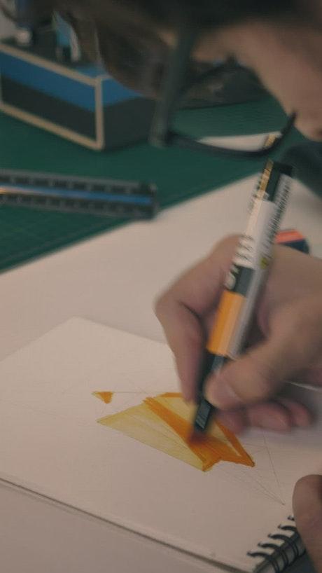 Designer coloring changing of drawing utensil