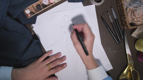 Designer drawing an outfit