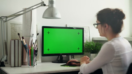 Designer working from home, green screen
