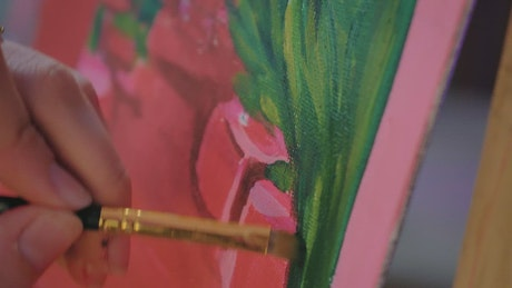 Detailed painting of an artist on the plants of an image