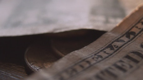 Details of a pair of battered old banknotes
