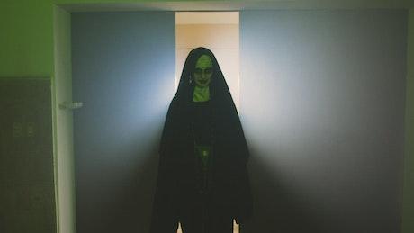 Devilish nun walking through a church