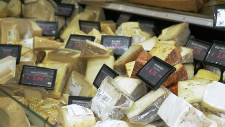 Different cheeses in a shop
