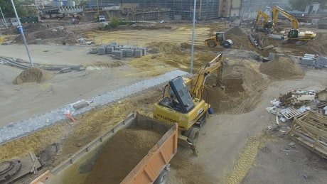 Diggers working in a construction site