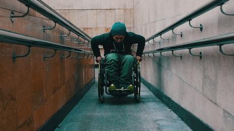 Disabled man going up a ramp