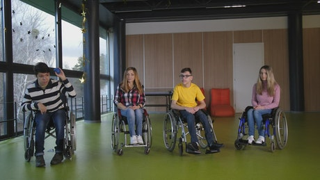 Disabled teens playing games