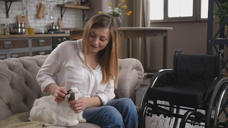 Disabled woman petting a cat