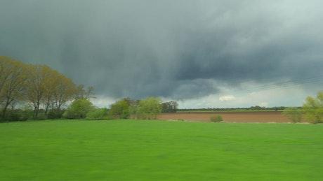 Distant rain across the countryside