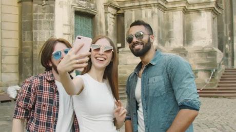 Diverse friends take selfie in London street