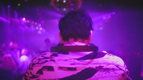DJ at a nightclub mixing music