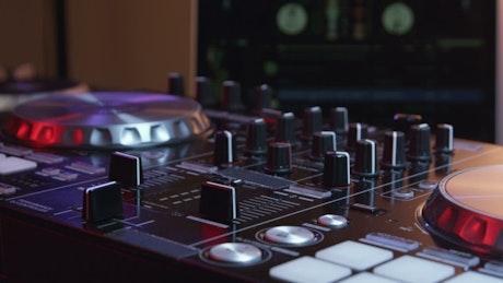 DJ configuring a mixing deck