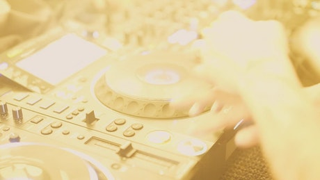 DJ on the decks mixing music